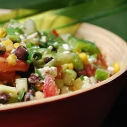 Black Bean, Corn, and Tomato Salad with Feta Cheese Recipe - This salad is dressed with a lime vinaigrette and has lots of crunch and flavor with a little jalapeno pepper pop. Use summer fresh ingredients from the garden or farmer's market.