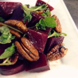 Roasted Beet, Arugula, and Walnut Salad Recipe - Roasted beets, arugula, and walnuts are tossed with balsamic vinegar and olive oil in this quick and easy, crunchy salad that happens to be vegan.