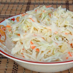 Hawaiian Cole Slaw Recipe - Coleslaw mix, pineapple, and onion are mixed in a creamy dressing in this sweet and tangy Hawaiian cole slaw recipe that is great will pulled pork.