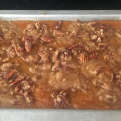 Sweet Potato Souffle II Recipe - Mashed sweet potatoes are baked with a buttery pecan and coconut topping in this casserole to serve with Thanksgiving dinner.