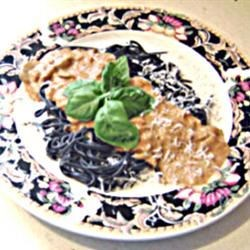 Black Pasta in a Pink Gorgonzola Sauce Recipe - Black squid ink pasta is tossed in a creamy sauce along with garlic, shallots and prosciutto.