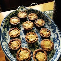 Festive Mincemeat Pastries  Recipe - Tender dough encloses a mincemeat and rum filling in a bell-shaped cookie that's perfect for holiday snacks or entertaining.