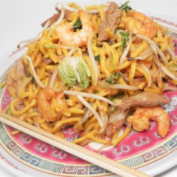 Fried Spicy Noodles Singapore Style   Recipe - Fresh Asian yellow noodles are stir-fried with beef, shrimp, Chinese mustard greens, bean sprouts, and a hot and flavorful paste made with lots and lots of garlic and hot red chilies.