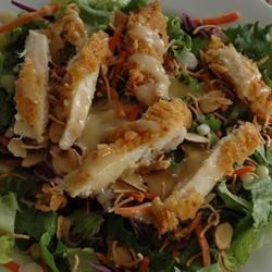 Chinese Chicken Salad II Recipe - This is a crisp lettuce salad with a zippy sweet and sour dressing.  Always a hit at a gathering, but doesn't store well. Very quick to prepare at the last minute.