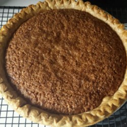 Oatmeal Pie II Recipe - When oatmeal goes into this pie 's simple filling, it bakes up all sweet and gooey, and tastes like pecans. This simple, last-minute pie goes great with scoops of ice cream or dollops of whipped cream.