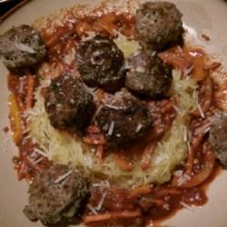 Spaghetti and Meatballs Paleo-Style Recipe - Give your spaghetti a makeover by adding quinoa to the meatballs and using spaghetti squash as a pasta substitute.