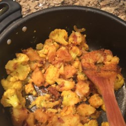 Nitya's Cauliflower Recipe - Cauliflower is sauteed with potatoes and a mix of spices to produce this delicious alternative to steamed cauliflower.