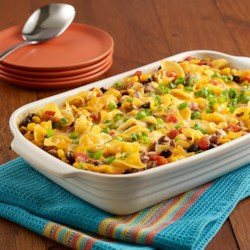 Beef Taco Noodle Casserole Recipe - Egg noodle casserole recipe with seasoned ground beef, Southwest vegetables, tomatoes and cheese.