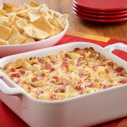 PAM's Creamy Artichoke-Tomato Dip Recipe - A warm cheesy dip recipe brimming with artichoke hearts and tomatoes to serve on pita chips or sliced French bread.