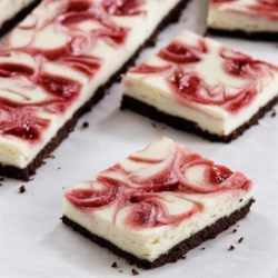 Raspberry Swirl Cheesecake Bars Recipe - Easy raspberry cheesecake bars with a chocolate graham cracker crumb crust, topped with a cream cheese layer and swirled with raspberry jam.