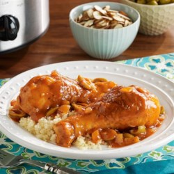 PAM's Slow Cooker Moroccan Chicken with Couscous Recipe - Chicken drumsticks cook slowly in a flavorful tomato sauce with onion and olives for slow cooker Moroccan chicken to serve with couscous.