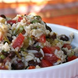 Black Bean and Rice Salad Recipe - This dish is summery and lower in fat than many, yet it's surprisingly filling. It's also simple to prepare and uses common ingredients.