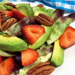 Strawberry Avocado Salad Recipe - Strawberries and avocadoes sit atop mixed salad greens and are dressed with a honey vinaigrette dressing. I have served this countless times and I am always asked for the recipe, I also use this dressing on many other salads. Enjoy