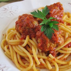 Bon Appetit's Meatballs Recipe - Ground pork, sweet Italian sausage, and ground beef are lightened with broth-moistened Italian bread and seasoned with garlic, Italian parsley, and Romano cheese. They're delicious plain or added to a pot of tomato sauce.