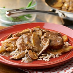 Pork with Apples and Mushrooms Recipe - Packed with savory flavor and a great source of lean protein, this simple pork dish comes alive with herbs, apples, mushrooms and the creamy goodness of mushroom soup.