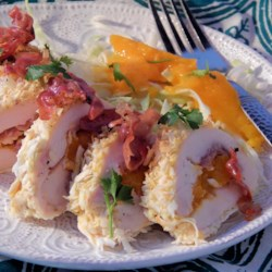 Caribbean Coconut Chicken Bites Recipe - Chicken rolls stuffed with prosciutto and mango and then rolled in coconut are fried for a crispy Caribbean-inspired appetizer.