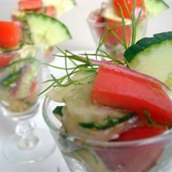Crispy Cucumbers and Tomatoes in Dill Dressing Recipe and Video - Crispy cucumbers, fresh tomatoes, and onion add spark to this simple summer salad.