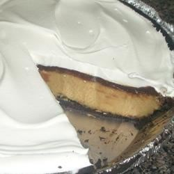 EZ Peanut Butter Pie II Recipe - This may not be the best peanut butter pie, but by golly, it's the EZest!!! Cook and serve pudding is combined with peanut butter in this classic made easy.