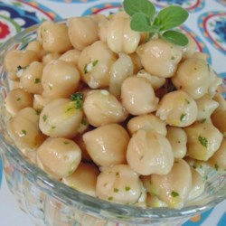 Marinated Chickpeas Recipe - Chickpeas are tossed in a lemony olive oil dressing with fresh herbs into this easy, Mediterrenean-inspired marinated chickpea recipe.