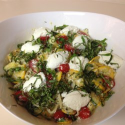 Linguine with Summer Squash, Tomatoes, and Basil Recipe - This summer pasta dish is made with fresh linguine tossed with zucchini, yellow squash, tomatoes, and ricotta cheese.
