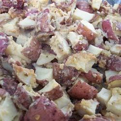 Parmesan Potatoes Recipe - Potatoes are peeled and cubed, coated with a mixture of Parmesan and flour, and baked with butter.