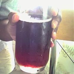A glass of Cherry Pomegranate Grape juice