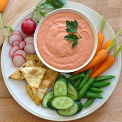 Spicy Roasted Red Pepper Yogurt Dip Recipe - Greek yogurt and pureed roasted red peppers is mixed with spices and Hidden Valley(R) Greek Yogurt Original Ranch(R) Dip Mix for a real party favorite.