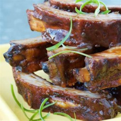 Backyard Baby Back Ribs Recipe - Baby back ribs are coated in a ranch dressing rub and baked for 3 hours creating tender and juicy ribs served with ranch barbeque sauce.