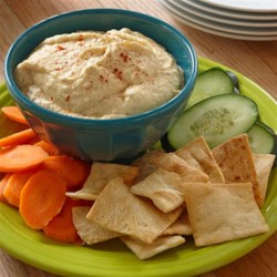 Roasted Garlic Hummus from Hidden Valley(R) Recipe - Hidden Valley(R) Original Ranch(R) Roasted Garlic Dressing makes a creamy, delicious addition to this quick and easy hummus.