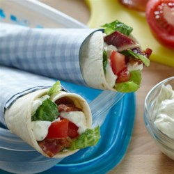 BLT Rancheros Recipe - Bacon, lettuce, and tomato are rolled up in tortillas spread with a creamy blend of sour cream, mayo, and Hidden Valley(R) Original Ranch(R) Salad Dressing & Seasoning Mix.