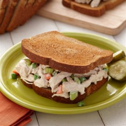 Garlic Chicken Salad Sandwiches Recipe - Shredded chicken tossed with Hidden Valley(R) ORiginal Ranch(R) Roasted Garlic Dressing and chopped veggies makes a quick and delicious filling for sandwiches.