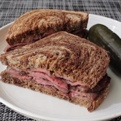 "Grilled Flank Steak ""Pastrami"" Recipe - While not a true pastrami, Chef John's Grilled Flank Steak is rubbed with similar seasonings and, sliced thin, makes a great sandwich on rye bread with honey mustard."