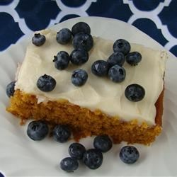 Pumpkin Bars III Recipe - These pumpkin bars are more like cake bars. Delicious pieces of baked pumpkin cake are topped with a sweet, creamy frosting.