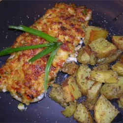 Crab Crusted Grouper Recipe - A crispy baked fish topped with a cheesy crab and pepper mixture. Easy to make, and nice to look at. This topping can also be used to stuff mushrooms. You may use any type of cheese that you like in this recipe - Italian cheeses work especially well.