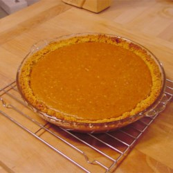 Fresh Pumpkin Pie Recipe - Pureed  pumpkin is stirred up with honey, spices, eggs, milk and cream, poured into a pie shell, and baked until set and fragrant.