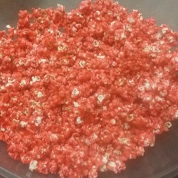 Kool-Aid(R) Popcorn Recipe - Kool-Aid(R)-coated popcorn is a colorful and addictive treat that the whole family will enjoy preparing and eating.