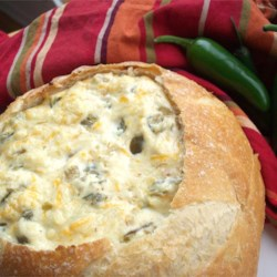Insanely Amazing Jalapeno Cheese Dip Recipe - Jalapenos, Parmesan cheese and Cheddar cheese are baked into a sourdough bread bowl to create this spicy dip.
