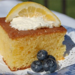 Lemon Poke Cake II Recipe - This is a moist lemony cake. It is called a poke cake because you poke holes in it to absorb the glaze.  If you want, you can serve this with vanilla ice cream or whipped topping.