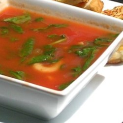 Tomato Florentine Soup I Recipe - Cooked pasta and chopped spinach are combined in this tomato and chicken broth based soup seasoned with a dash of nutmeg.