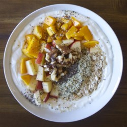 Morning Fruit Bowl Recipe - This morning fruit bowl provides a healthy meal to start the day, a parfait including Greek yogurt, fruit, oats, chia seeds, hemp seeds, and walnuts.
