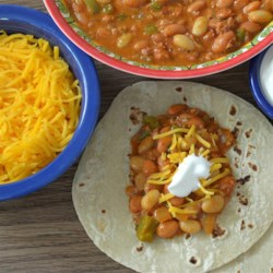 Chorizo and Beans Recipe - This is a Mexican-American dish that has a surprisingly tasty flavor although some may laugh at the type of beans used. My mother made it for us as children.