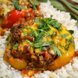 Stuffed Mexican Peppers Recipe - Mexican-inspired ground beef and rice stuffing fills red or green bell peppers for a family-pleasing meal.