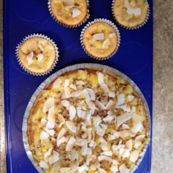 Hawaiian Cheesecake Recipe - This cheesecake in a prepared graham cracker crust is studded with coconut and pecans.