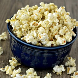 Italian Popcorn with Parmesan Recipe - Popcorn tossed with Italian seasoning, garlic salt, and Parmesan cheese is a fun Italian-inspired popcorn snack perfect for movie night.