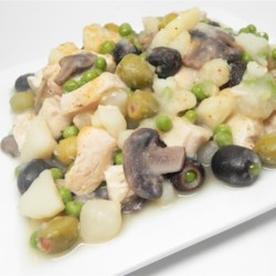Chicken Oliver Recipe - Pan seared chicken breasts are simmered in chicken stock with potatoes, olives, green peas, and herbs. A nice twist of a chicken dish that goes great with crusty French bread.