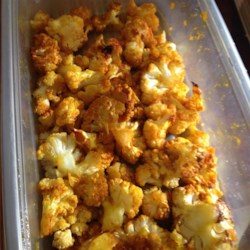 Popcorn Cauliflower Recipe - Bite-size cauliflower pieces are coated in a sweet and savory spice blend and roasted into a popcorn-like treat you can serve as a side dish or snack.