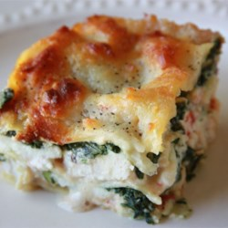 Lasagna Alfredo Recipe - Lasagna with chicken, ricotta and spinach is baked with Alfredo sauce and mozzarella cheese.