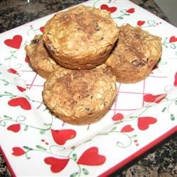 Applesauce-Oat Muffins Recipe - These cinnamon-spiced muffins are so good for a winter breakfast when served warm.