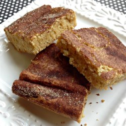Snickerdoodle Blondies Recipe - Traditional blondies are topped with a cinnamon topping and a cinnamon-vanilla glaze creating snickerdoodle blondies that are a snap to make.