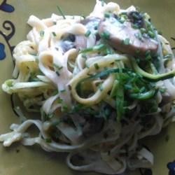 Zucchini Linguine Alfredo Recipe - Shredded zucchini adds flavor and texture to a lightened-up version of creamy linguine Alfredo made with portobello mushrooms and prepared mushroom Alfredo sauce.